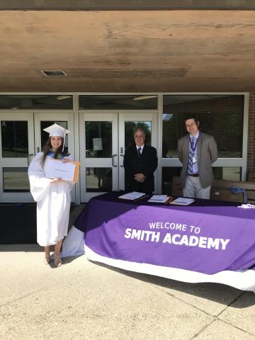 Emily collects her HS diploma from Mr Roberts & Mr Buckland